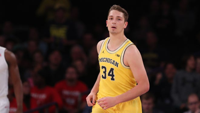 Michigan forward Mark Donnal (34) runs up the court during the championship game of the 2016 2K Classic against SMU at Madison Square Garden.