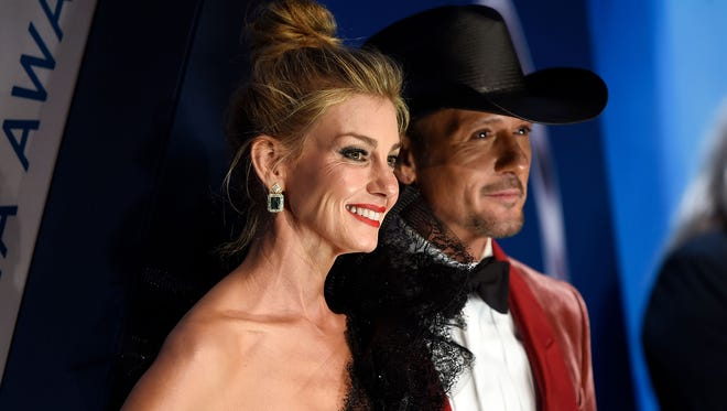 Faith Hill and Tim McGraw on the red carpet at Music City Center in Nashville before the start of the 51st annual CMA Awards on Wednesday, Nov. 8, 2017.