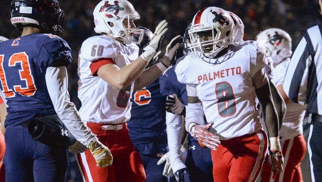 Palmetto sophomore Dez Frazier(8) is congratulated after scoring during the second quarter of the Class AAA 2017 SCHSL Football State Championships at Chapman High School in Inman on Friday.
