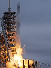 The SpaceX Falcon 9 rocket, carrying a Dragon cargo