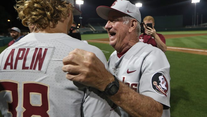 FSU Head Coach Mike Martin hugs Rhett Aplin as he becomes the NCAA's all-time winningest coach with a 3-2 victory over Clemson during their game at Doug Kingsmore Stadium in Clemson, S.C. on Saturday, May 5, 2018.