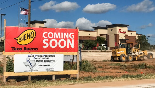 A sign states Taco Bueno is opening a second location behind the Chick-fil-A on Sherwood Way in San Angelo.