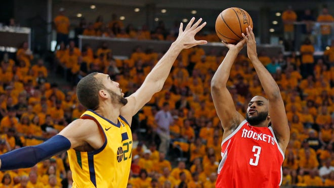 Utah Jazz center Rudy Gobert defends against Houston Rockets guard Chris Paul during the first half in Game 4.