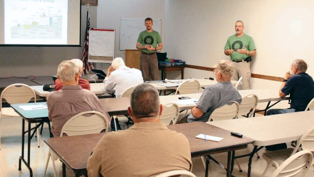 In this May  22, 2015 file photo, Ted Brinegar and Darron Williams of Foxhole Homes shared about their organization's mission to build low-impact homes for homeless veterans at the Alamogordo Public Library Thursday. The Alamogordo chapter of the New Mexico Solar Energy Association invited the recently-formed nonproft to give a presentation about environmentally-friendly housing solutions at its monthly meeting.