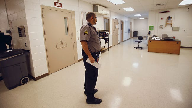 An employee at the San Juan County Adult Detention Center checks the medical unit at the detention center in Farmington on May 8. Employees did not provide their full names because of security concerns.