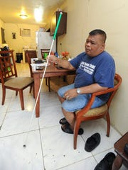 Merizo resident Frank Ungacta, 42, talks about his introduction to using a white cane, during an interview in his apartment on Thursday, Oct. 6.