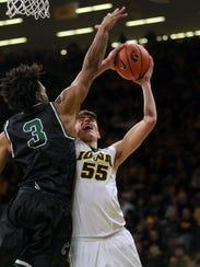 Iowa's Luka Garza draws a foul as he goes up for a
