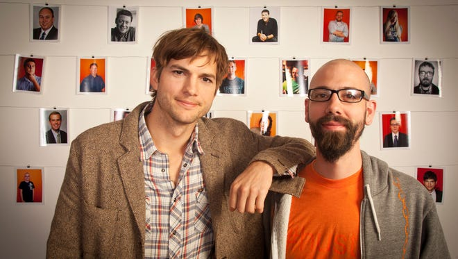 Dwolla founder and CEO Ben Milne, right, and Ashton Kutcher in the offices of Dwolla in Des Moines Tuesday April 10. 2012. Kutcher was one of the investors announced during Dwolla'??s funding round.