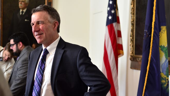Gov. Phil Scott lingers after a news conference at his office in the Vermont Statehouse in Montpelier on Feb. 2, 2017.