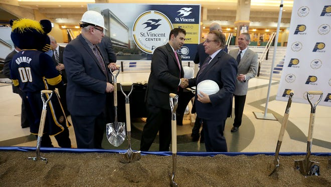 The Indiana Pacers held a groundbreaking ceremony for the St. Vincent Center practice facility Monday, December 14, 2015, at Bankers Life Fieldhouse. Here Pacers owner Herb Simon,right, and St. Vincent CEO Jonathan Nalli shake hands.