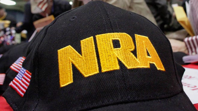 A hat displays the National Rifle Association logo at an Illinois Gun Owners Lobby Day convention in Springfield, Ill., March 7, 2012.