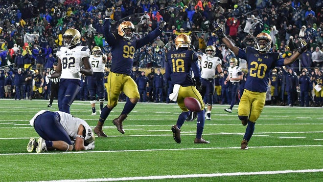 Nov 18, 2017; South Bend, IN, USA; Navy Midshipmen wide receiver Tyler Carmona (88) reacts while Notre Dame Fighting Irish defensive lineman Jerry Tillery (99) cornerback Troy Pride Jr. (18) and cornerback Shaun Crawford (20) celebrate after Carmona missed a catch in the in the fourth quarter at Notre Dame Stadium. Mandatory Credit: Matt Cashore-USA TODAY Sports