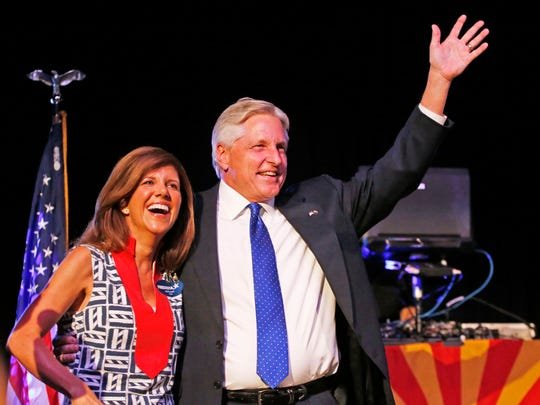 """Campaign officials for Democratic candidate Fred DuVal (here with his wife, Jennifer) say the gubernatorial race against Republican Doug Ducey will not be determined by """"dark money."""""""
