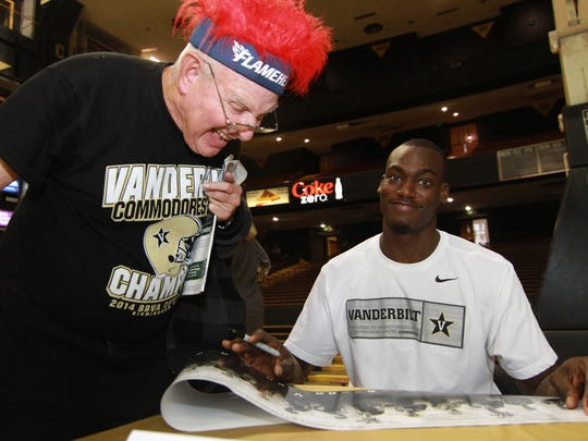 Ivan Weinstein, 74, a Vanderbilt fan since 1953, is delighted by getting his poster signed by Basketball player Djerry Baptiste on Dore Day in Nashville, Tenn. on Sun. Oct. 25, 2015.
