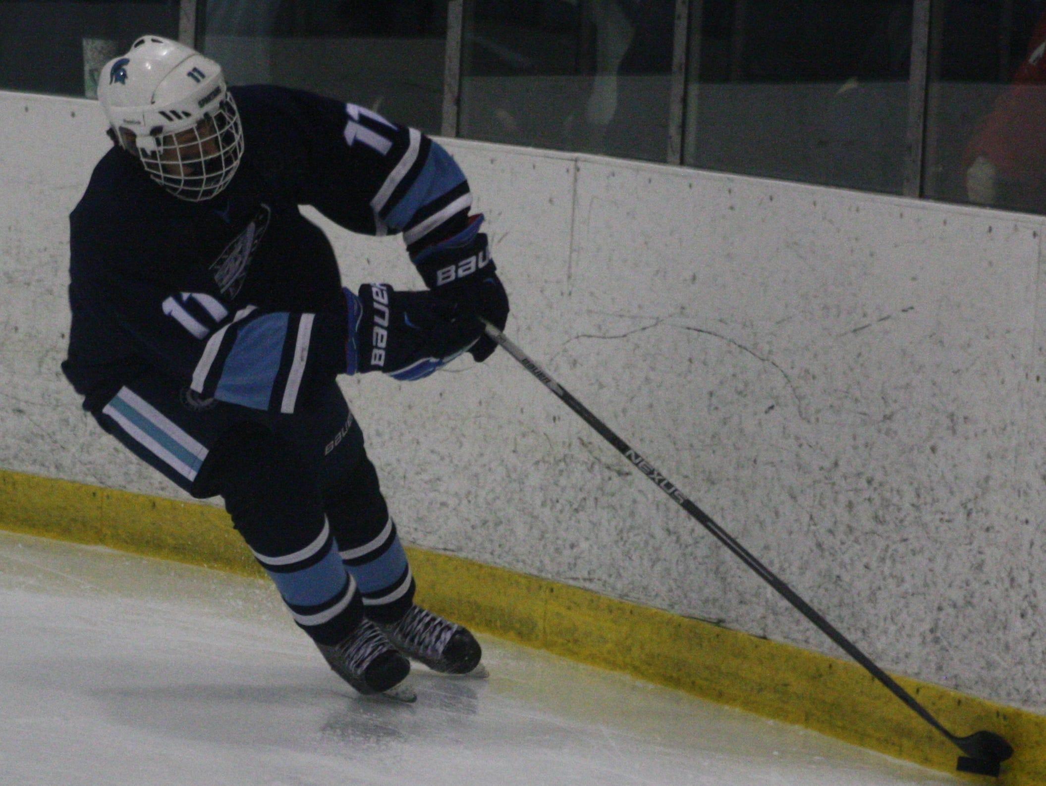 Stevenson's Sam Judd steers the puck around the boards Wednesday night.
