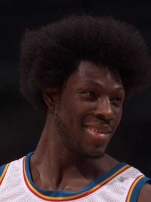 Detroits Ben Wallace sports a afro against Sacramento