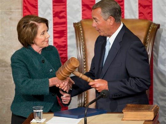 FILE - In this Jan. 6, 2015 file photo, House Speaker John Boehner of Ohio is handed the gavel from House Minority Leader Nancy Pelosi, D-Calif, after being re-elected for a third term to lead the 114th Congress, as Republicans assume full control for the first time in eight years, on Capitol Hill in Washington. Pelosi is bruising some key liberal allies by helping craft a rare bipartisan accord on Medicare. Lawmakers say it will enhance her deal-making status. And it might help her party avoid being sidelined by majority Republicans on future issues.