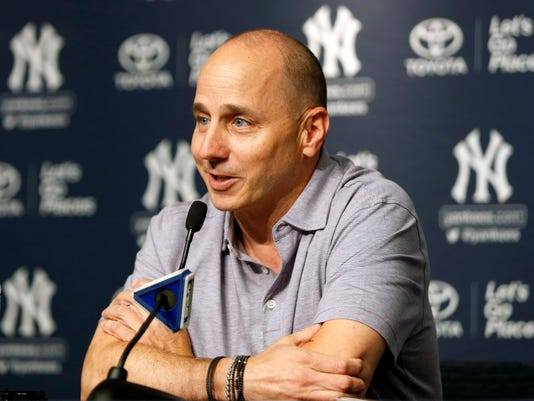 ee3b15c73392d New York Yankees general manager Brian Cashman speaks to reporters during a  news conference in which