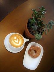 A peach bourbon doughnut and a beautiful latte make