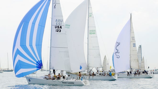 Good Lookin', of the Port Huron Yacht Club; Velero VII, of Bayview Yacht Club; and White Water Dragon, of Bayview Yacht Club, race up the lake July 18, 2015, during the start of the Port Huron-to-Mackinac Island Sailboat Race.