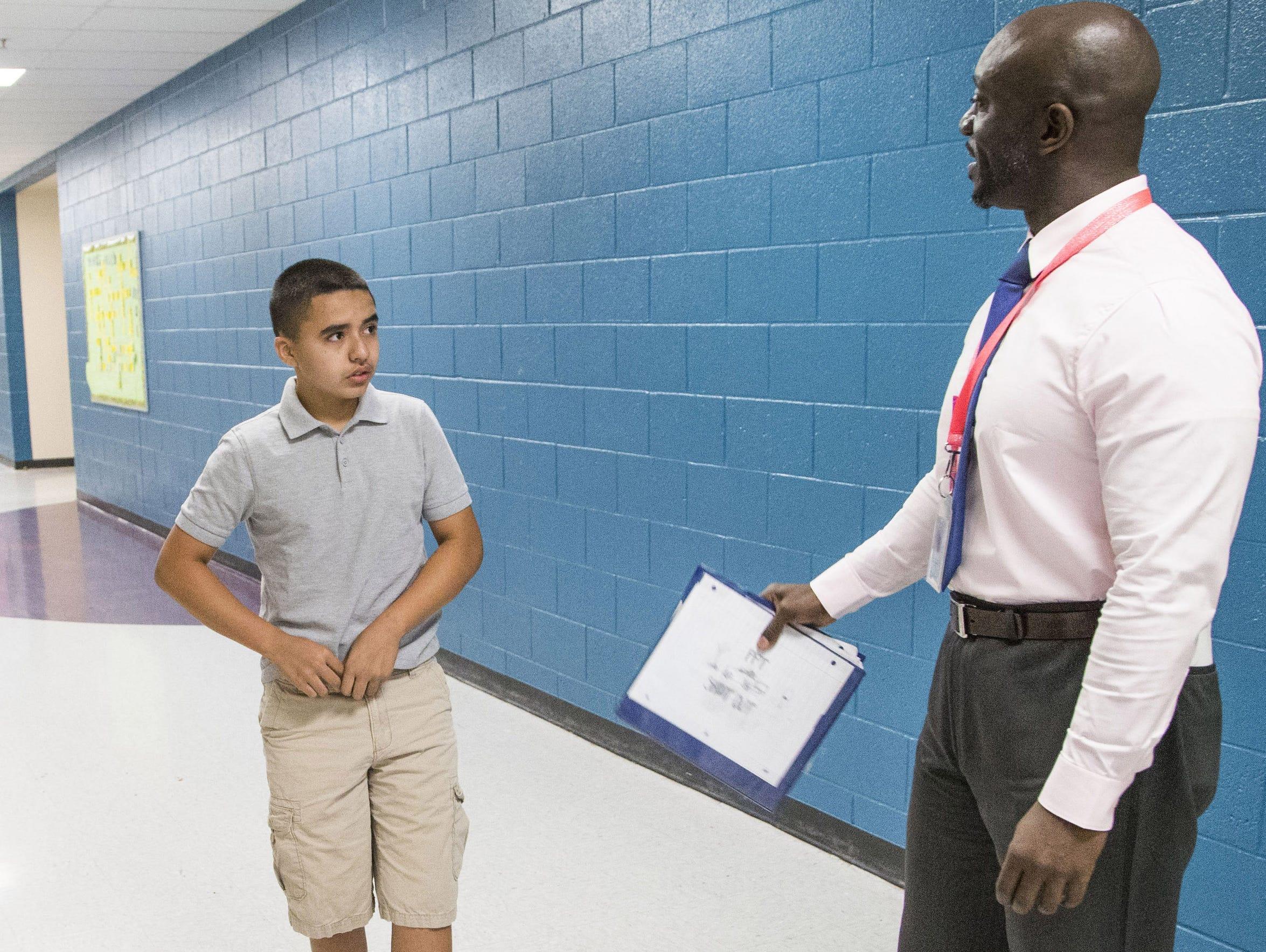 Principal Eric Atuahene reminds student Alex Mata Cevas