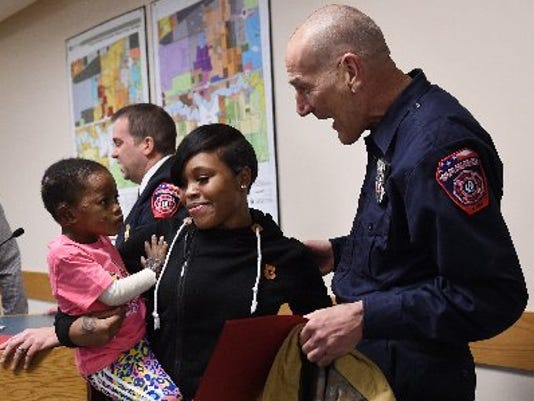 635955422284884147-Firefighter-Honored2-MIARB.jpg