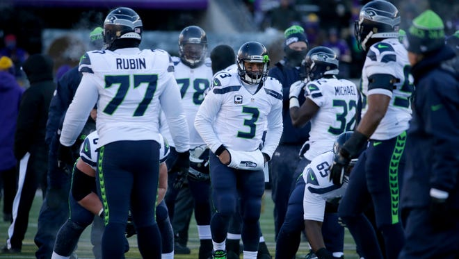 Seattle Seahawks quarterback Russell Wilson (3) warms up before an NFL wild-card football game against the Minnesota Vikings, Sunday, Jan. 10, 2016, in Minneapolis.
