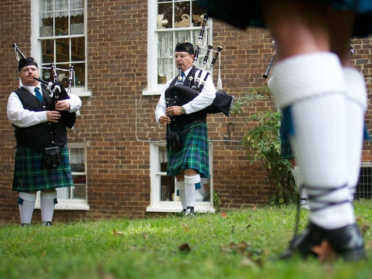 Kurt Taylor, left, and Vince Ayub, right, of Knoxville Pipe and Drums practice for the last time before the parade during the Scots-Irish Music Festival in Dandridge, Tenn., on, September 28, 2013.    (Shawn Millsaps/Special to the News Sentinel)