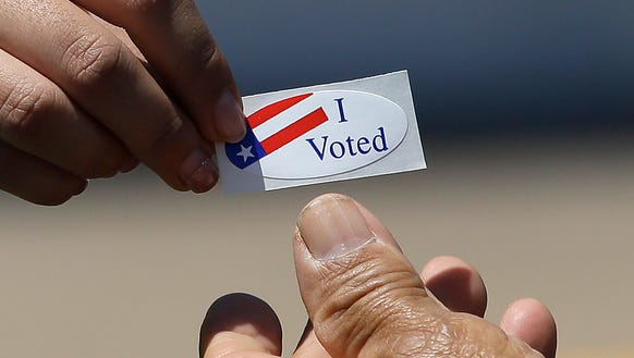Kimberlee Weaver, left, an election worker for the