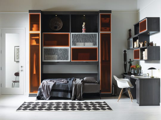 A creative wall bed makes this office space from California Closets more functional.