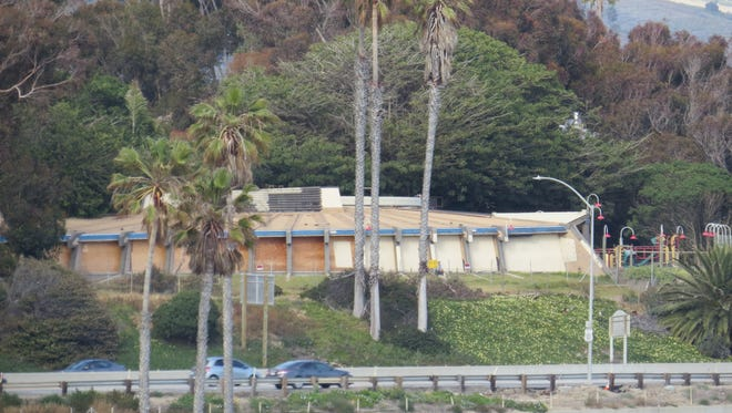 Perched on a bluff overlooking Highway 101, the former Chart House restaurant building in Ventura was boarded up after the closure of Joe's Crab Shack in September 2015. Developers hope to build a luxury apartment complex in its place.