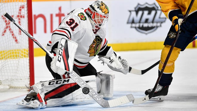 Blackhawks goaltender Anton Forsberg stops a shot from Predators left wing Pontus Aberg (46) in the first period Tuesday at Bridgestone Arena.
