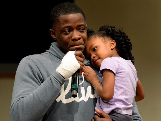 James Shaw Jr. holds his daughter, Brooklyn Shaw, 4, and cries while speaking during a prayer vigil for those affected by the Waffle House shooting, at Mount Zion Baptist Church in Antioch on April 23.