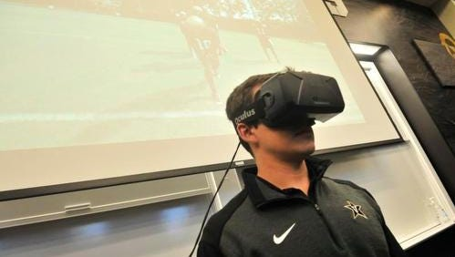Vandy's Assistant Director of Video Productions Josh Pohl demonstrates the use of virtual reality gear in the Vanderbilt team meeting room in the McGugin Center on the Vanderbilt University campus in Nashville, Aug.28, 2015.  Vanderbilt football is using virtual reality technology to help train its players