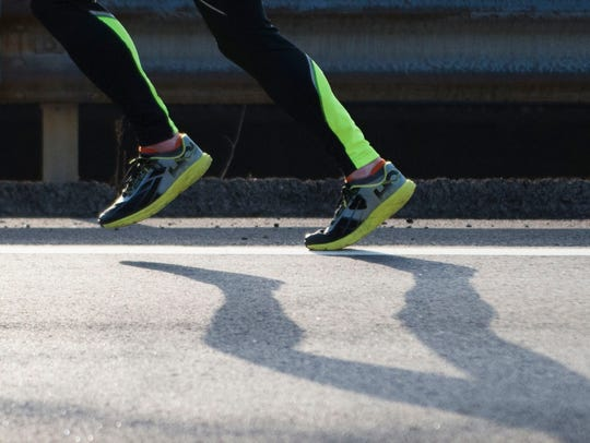 A participant runs in Calhoun's New Year's Day 5K run