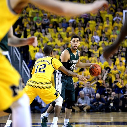 Spartans guard Denzel Valentine gets the offense set