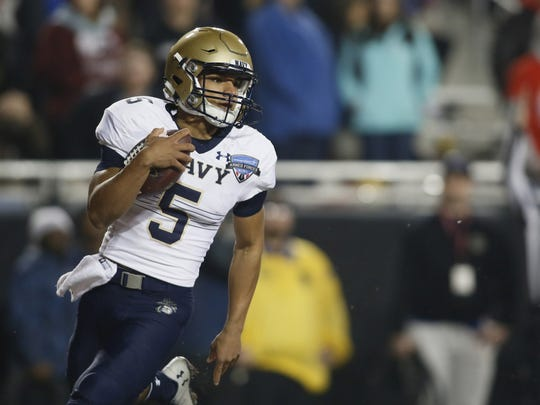 Navy Midshipmen quarterback Malcolm Perry (5) scores a touchdown in the fourth quarter against the Louisiana Tech Bulldogs at Amon G. Carter Stadium last year.