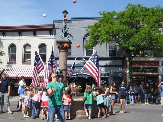 Juggler Joe Showers performs in front of Geneseo's bear fountain during the Memorial Day celebration in 2009.