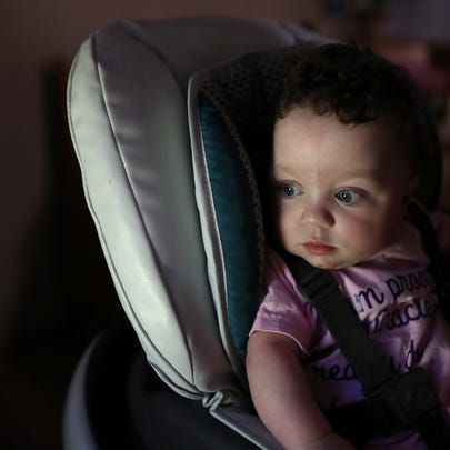 Lilly June, 11 months, is strapped into her feeding
