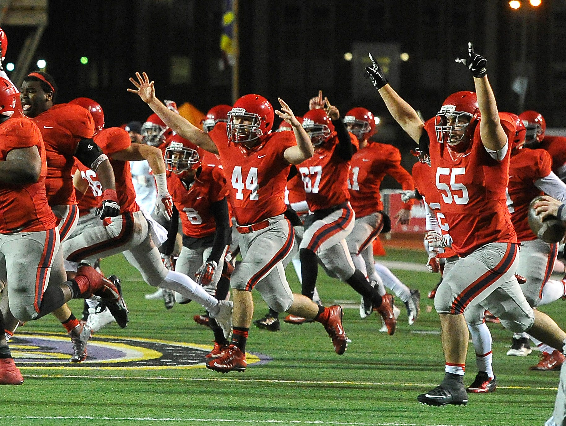 Brentwood Academy players celebrate their 56-55 double-overtime win over Montgomery Bell Academy in the BlueCross Bowl DII-AA state title game on Dec. 3, 2015, in Cookeville.