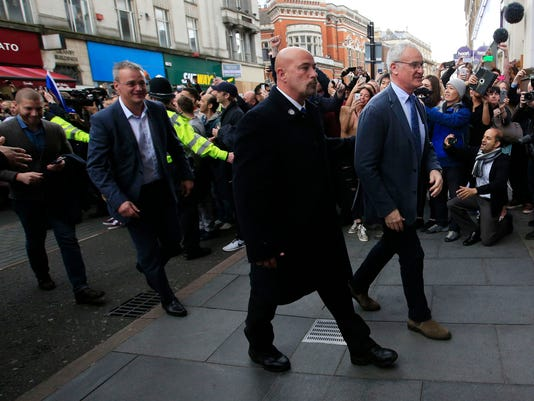 Leicester City manger Claudio Ranieri, right, arrives at San Carlo Pizzeria for a celebratory lunch in Leicester, England Tuesday May 3, 2016. Leicester  clinched the most improbable title of the Premier League era when second-place Tottenham was held to a 2-2 draw at Chelsea on Monday night.  (Jonathan Brady/PA via AP)  UNITED KINGDOM OUT
