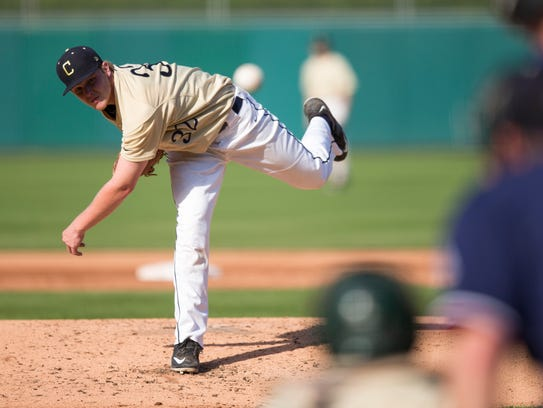 Nick Eaton of Cathedral High School, works on pitching