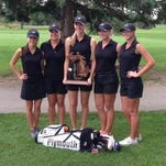 Heather Muir (from left), Ariana Strzalka, Katie Chipman, Alaina Strzalka and Erin Johnson pose with the 2015 Division 1 regional championship trophy at Fox Hills. Muir and Johnson are back for the 2016 Wildcats.