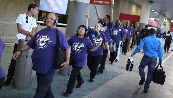 U S Airport Workers Stage One Day Strike