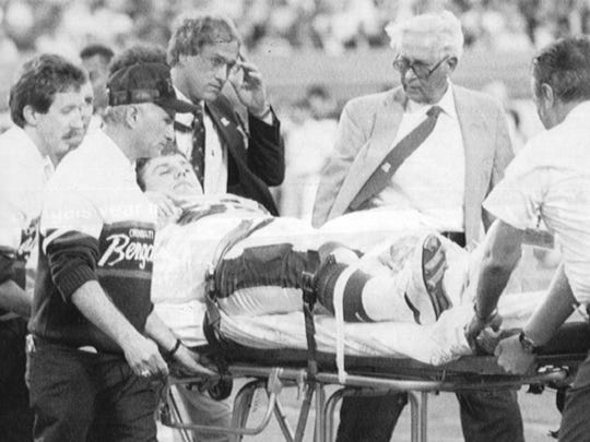 Nose tackle Tim Krumrie is carted off the Orange Bowl field by stretcher after suffering a broken leg in the first quarter of the Super Bowl in 1988.