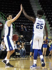 Texas A&M-Corpus Christi's Ehab Amin and Rashawn Thomas (25) hi-five after their victory against Central Arkansas on Saturday, Jan. 14, 2017, at the American Bank Center.