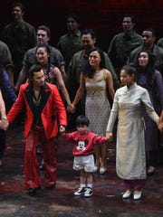 """Actors Jon Jon Briones and Jace Chen and actress/singer Eva Noblezada take part in the curtain call on the opening night of """"Miss Saigon"""" Broadway at the Broadway Theatre on March 23, 2017 in New York City.  (Photo by Michael Loccisano/Getty Images)"""