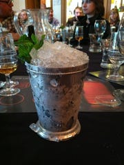 A mint julep served in a traditional metal cup