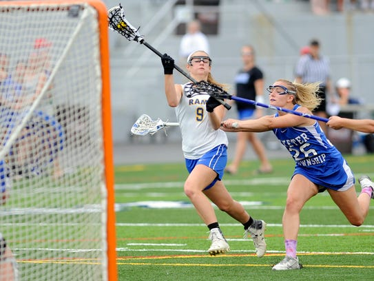 Kennard-Dale's Megan Halczuk takes a shot on goal while