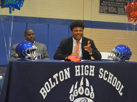 Bolton linebacker Terrance Garnett (right) signed with